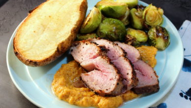 pork steak with persimmon puree, baked potato and brussels sprouts